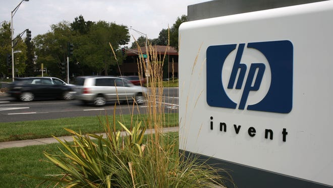 The HP logo is displayed on the entrance to the Hewlett-Packard Headquarters September 16, 2008 in Palo Alto, Calif.