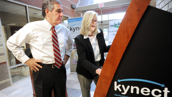 Carrie Banahan, with Lt. Gov. Jerry Abramson, is executive director of Kentucky's Health Benefits Exchange.
