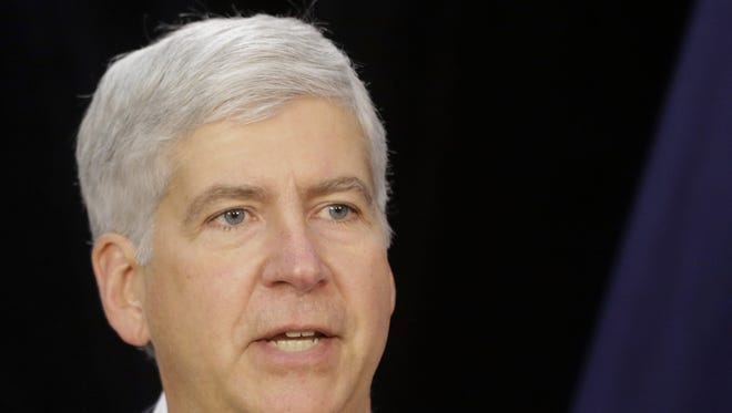 Michigan Gov. Rick Snyder, shown in  this July 19, 2013, file photo, is proposing to use $350 million in state funds over 20 years to help protect the pensions of Detroit retirees and the art collection of the Detroit Institute of Arts, a source said.