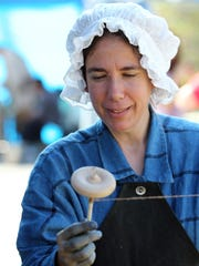 Renee Gillespie demonstrates how to hand spin cotton during the Standpipe Festival in downtown Belton.