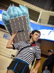 Kyle Ordille walks the steps selling cotton candy during the PIAA Championships.