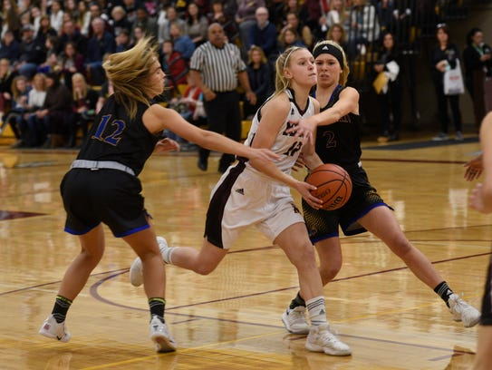 Mercy's Jenna Schluter finds the going tough against
