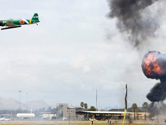 Planes reenact the attack on Pearl Harbor during a