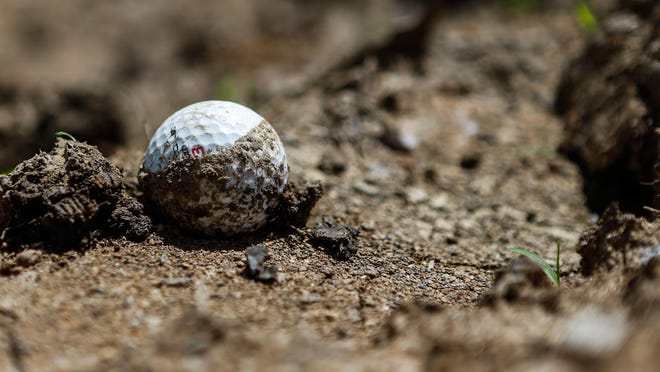 A muddied golf ball lays among the housing redevelopment site on top of the former Crooked Tree Golf Course in Mason, Ohio. With younger generations expressing less interest in golf, some courses have begun to sell their land for other uses.