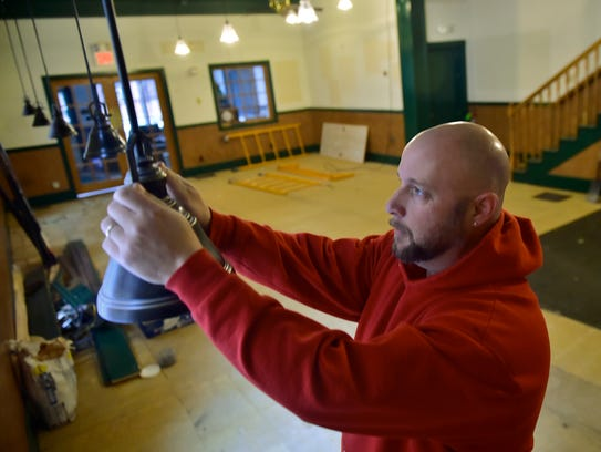 Rick Yohe, owner of R A Yohe, works Monday, January