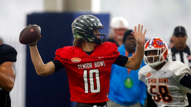 Oregon's Justin Herbert throws a pass as the South squad practices for the Senior Bowl Thursday, Jan. 23, 2020, in Mobile, Ala.