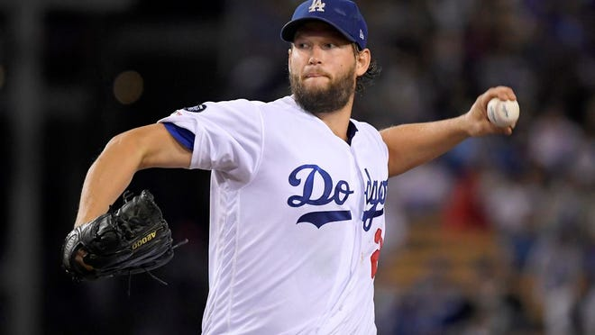 From Sept. 20, 2019, Los Angeles Dodgers starting pitcher Clayton Kershaw pitches to the Colorado Rockies baseball team in Los Angeles. In what's become a familiar refrain, the Dodgers arrive at camp still looking for their first World Series championship since 1988. After losing in two straight World Series, they were ousted by Washington in five games in the NL Division Series last fall. The team had a quiet offseason,