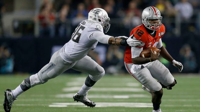 Ohio State quarterback Cardale Jones eludes Oregon linebacker Christian French during the most-recent game between the Buckeyes and Ducks, the national championship game on Jan. 12, 2015.