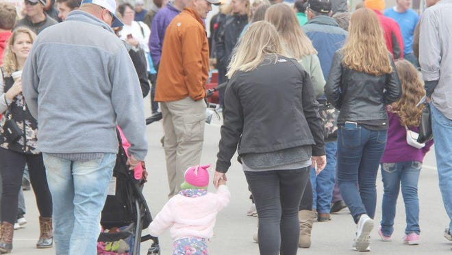 Daily Express file photo showing visitors and families filling the Kirksville downtown square for the Red Barn Arts and Crafts Festival.