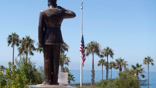 FILE - The U.S. flag was lowered to half-staff at Park Semper Fi in San Clemente, Calif., on Friday, July 31, 2020. Eight troops aboard a landing craft that sank off the Southern California coast during a training exercise are presumed dead, the Marine Corps announced Sunday, Aug. 2, 2020. The Marines said they had called off the search that started late Thursday afternoon when the amphibious assault vehicle sank with seven Marines and one sailor aboard.