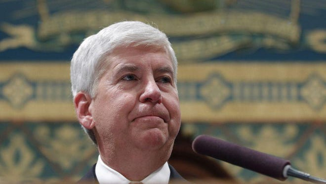 In this Jan. 17, 2017, file photo, Michigan Gov. Rick Snyder delivers his State of the State address to a joint session of Legislature at the Capitol in Lansing.