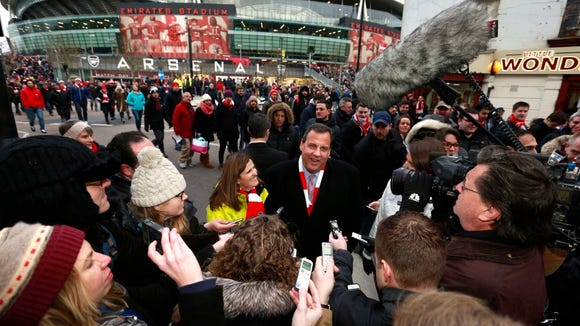 Gov. Chris Christie and First Lady Mary Pat Christie talk to the press after attending a soccer match in London on Sunday, Feb. 1, 2015. (Governor's Office/Tim Larsen)