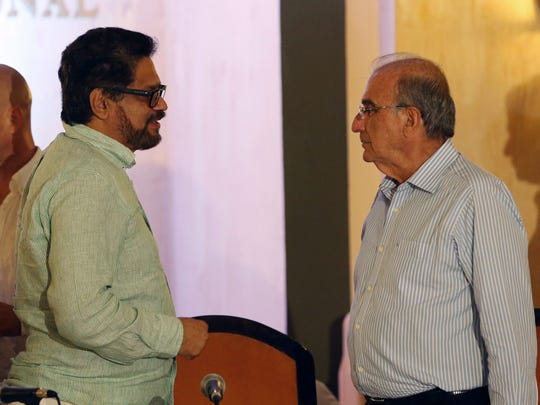 Ivan Marquez (left), a commander of the Revolutionary Armed Forces of Colombia, or FARC, talks with chief negotiator of the government of Colombia Humberto de la Calle in Havana, Cuba, on May 15, 2016.