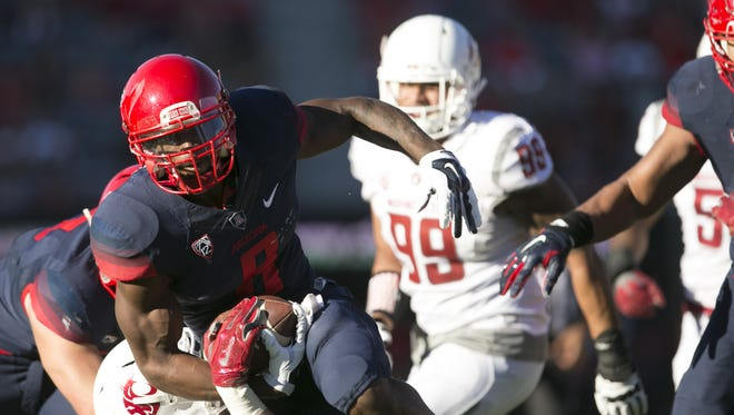 UA quarterback Jerrard Randall carries the ball against Washington State during the fourth quarter of the Pac-12 college football game at Arizona Stadium in Tucson on Saturday, October, 24, 2015.