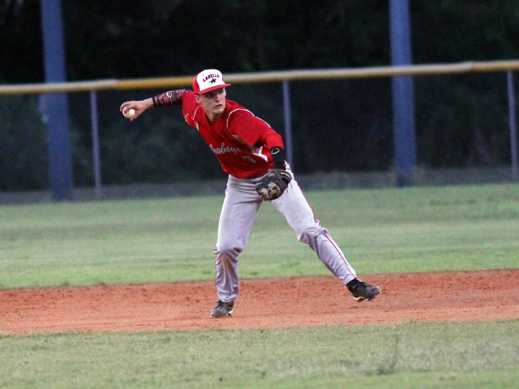 Tyler Vetton throws to first during Friday's district final game against Bishop Verot
