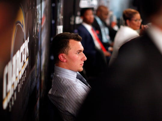 Johnny Manziel, from Texas A&M, waits backstage during the first round of the NFL football draft, Thursday, May 8, 2014, at Radio City Music Hall in New York. (AP Photo/Jason DeCrow)