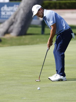 Tournament leader Xander Schauffele putts for birdie on the 18th hole Saturday during the third round of the Charles Schwab Challenge at Colonial Country Club in Fort Worth, Texas.
