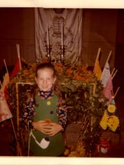 Rebecca Garfein as a five year old in front of the sukkah enclosure after singing for her congregation at Temple Israel.