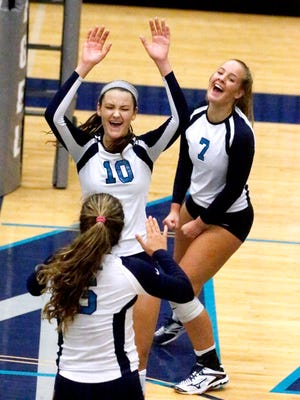 Siegel's Julia Wheeler (5), Grace Reidmiller (10) and Ashley Wessner (7) celebrate a point in the Class AAA sectional against Walker Valley, on Thursday.