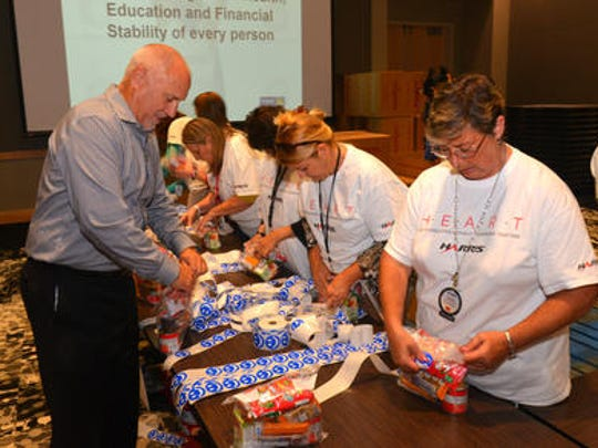 Approximately 400 local Harris Corp. employees spent their lunch hour Wednesday at the Harris Technology Center assembling 11,000 food packs that will be donated to the Children's Hunger Project . This was the kick off to the company's United Way campaign