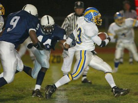 Nate Harris (9) was a football star at New Brunswick,