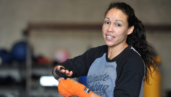UFC fighter Marion Reneau wraps her hands before training