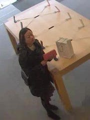 Police say this woman used a fraudulent credit card to purchase two iPhones.