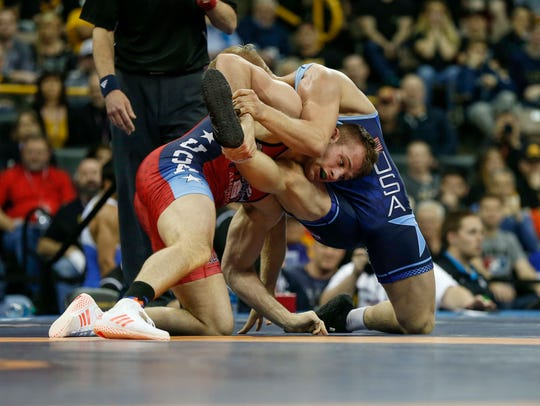 David Taylor of the Nittany Lion Wrestling Club, left,