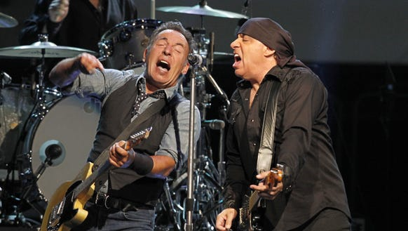 Bruce Springsteen, left, and guitarist Stevie Van Zandt