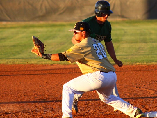 White Sands first baseman Joe Borowski stretches out for a ball during a pick off attempt Tuesday evening.