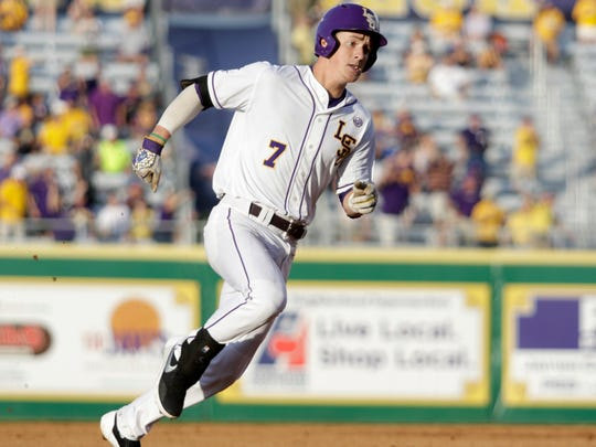 Greg Deichmann rounds third base on his way to an inside the park grand slam on Sunday at Alex Box Stadium in the Baton Rouge Regional of the NCAA Division 1 Baseball Championship.
