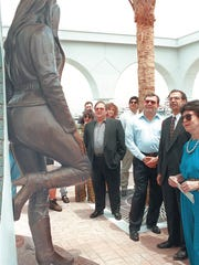 Abraham Quintanilla (left) gathers with friends and city dignitaries at the unveiling of the Selena memorial statue at the Mirador de la Flor on May 25, 1997.