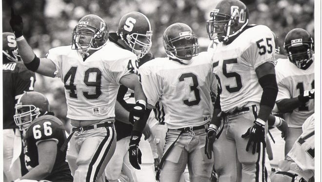 Central Michigan players celebrate during their 24-20 victory over Michigan State to open the 1992 season at Spartan Stadium.