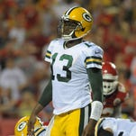 Green Bay Packers quarterback Vince Young (13) looks to the sidelines during the second half of the game against the Kansas City Chiefs at Arrowhead Stadium. The Chiefs won 30-8.