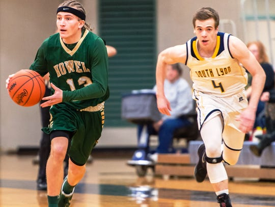 Howell's Johnny Shields (left) gets past South Lyon's