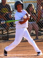 A Tularosa player makes contact with a pitch Friday