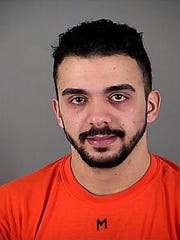"Samy Mohamed Hamzeh is seen in an undated photo provided by the Waukesha County (Wis.) Sheriff''s Department. Federal prosecutors charged 23-year-old Samy Mohamed Hamzeh on Tuesday with unlawfully possessing a machine gun and receiving and possessing firearms not registered to him. Federal agents said Tuesday that Mohamed Hamzeh wanted to storm a Masonic temple with a machine gun and kill at least 30 people in an attack he hoped would show ""nobody can play with Muslims"" and spark more mass shootings in the United States."