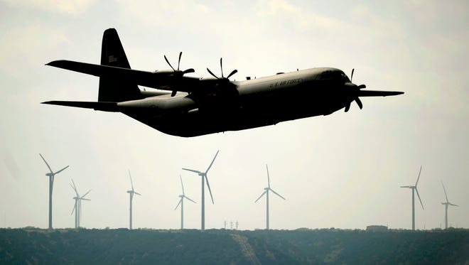 A Dyess C-130J climbs in the air above the Trent wind farm on Friday, April 8, 2011.