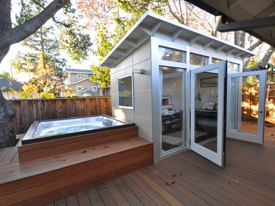 Jennifer and Eric Antonow built a shed near their backyard hot tub to create some extra living space at an affordable price in Palo Alto, Calif.