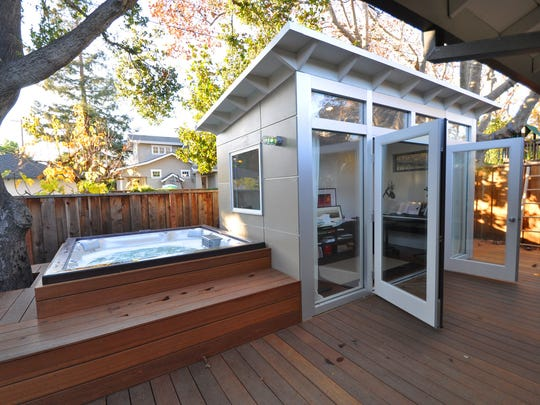 The shed Jennifer and Eric Antonow built near their backyard hot tub provides some extra living space in Palo Alto, California. The high cost of California real estate made the shed a more affordable option than building an addition.