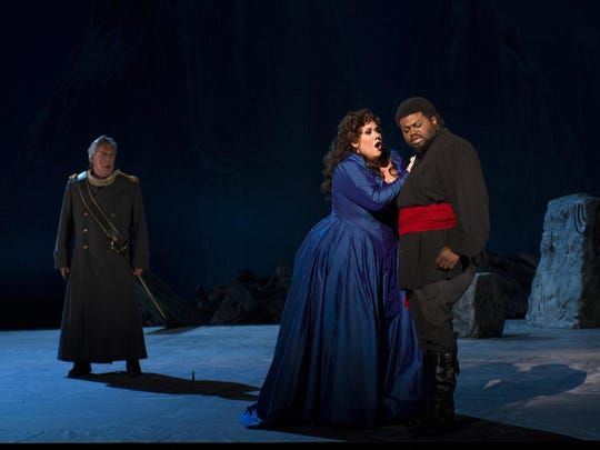 "Count di Luna (Stephen Powell) looks on as Leonora (Julianna Di Giacomo) professes her love for Manrico (Russell Thomas) in Cincinnai Opera's ""Il Trovatore"""