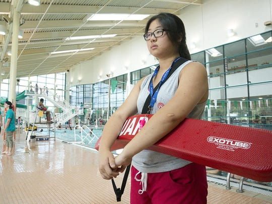 Summit lifeguard Jesse Zhou keeps an eye on a crowd of youngsters in the pool. Upcoming renovations will include painting and tile work in the aquatics center.