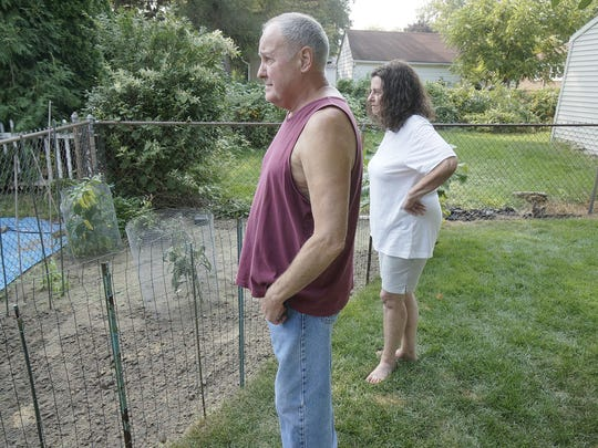 Bill Coatta and Linda Brown are battling rats in their yard and neighborhood. They removed vegetation that serves as cover for the rodents and pulled up most of their garden, a food source. They have trapped at least 20.