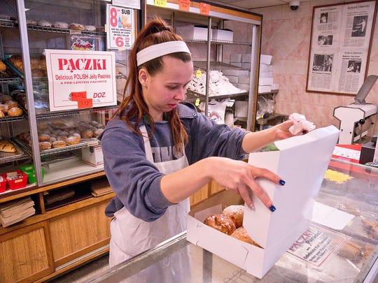 Ashley Bagazinski boxes up a dozen paczki for a customer.