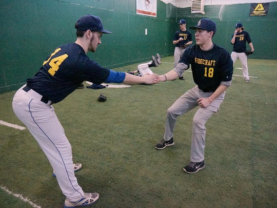 Working in tandem on a conditioning drill are Schoolcraft College pitchers Nick Montroy (left) and Donovan Thacker.