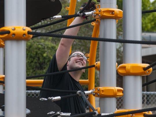 Volunteer Jason Cavanaugh double-checks the portion