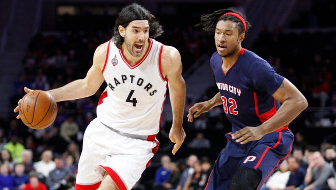 Raptors forward Luis Scola (4) drives to the basket against Pistons forward Justin Harper (32) during the first quarter at The Palace of Auburn Hills on Feb. 28.