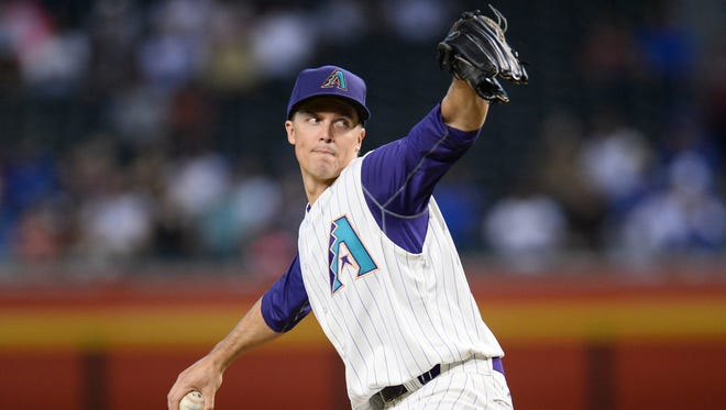Aug 31, 2017; Phoenix, AZ, USA; Arizona Diamondbacks starting pitcher Zack Greinke (21) pitches against the Los Angeles Dodgers during the first inning at Chase Field. Mandatory Credit: Joe Camporeale-USA TODAY Sports