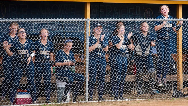 The Essex bench reacts to a base hit against Colchester during Tuesday's Division I softball semifinal at Essex.