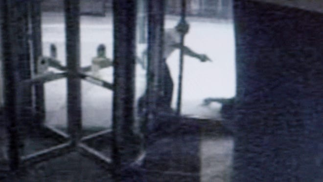 A snapshot taken from a surveillance camera shows the struggle between Cincinnati Police Officer, Oscar Cyranek, and sixteen-year-old, Davon Mullins on Fountain Square, downtown. Mullins was shot and killed by the officer, after he presented a gun.